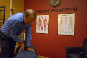 Photo of Dr. Dahl giving a chiropractic adjustment