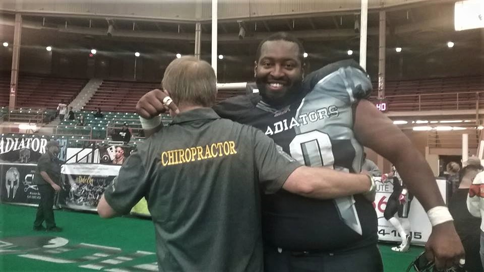 Photo of Dr. Eric Dahl with a Duke City Gladiators player
