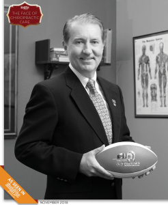 Photo of Dr. Eric Dahl holding a football