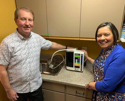 Photo of Dr. Eric and Emma with their new Kangen Water Machine