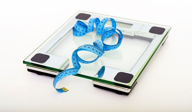 Photo of weight scales with measuring tape