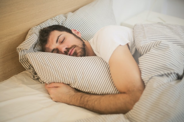 Photo of a man sleeping comfortably