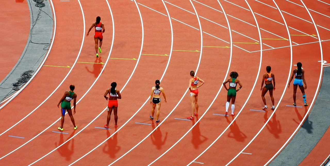 Track and field runners lining up for a race