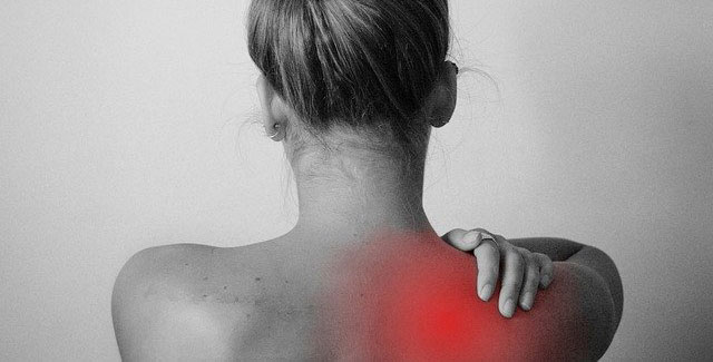 Photo of a woman with shoulder pain